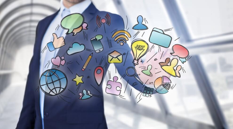 Businessman touching multimedia icons