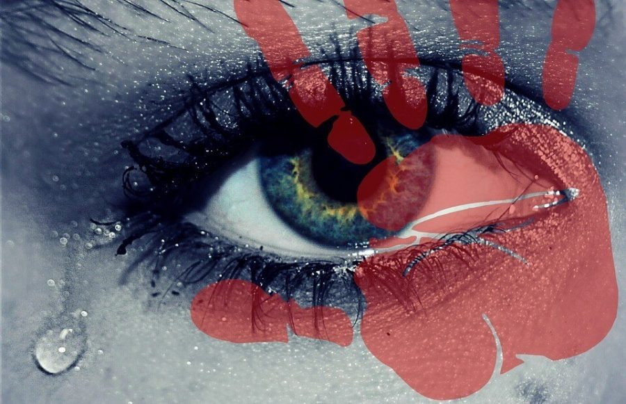 Eyes with red hand