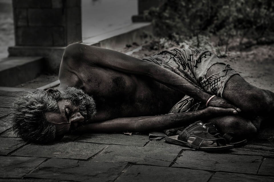 Man lying on the street