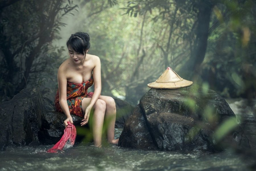 Woman at the waterfall
