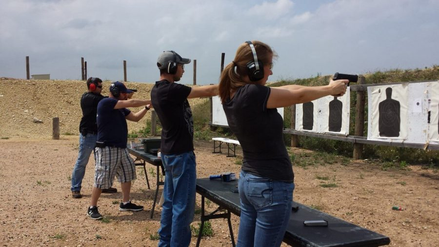 a group of people practicing how to shoot