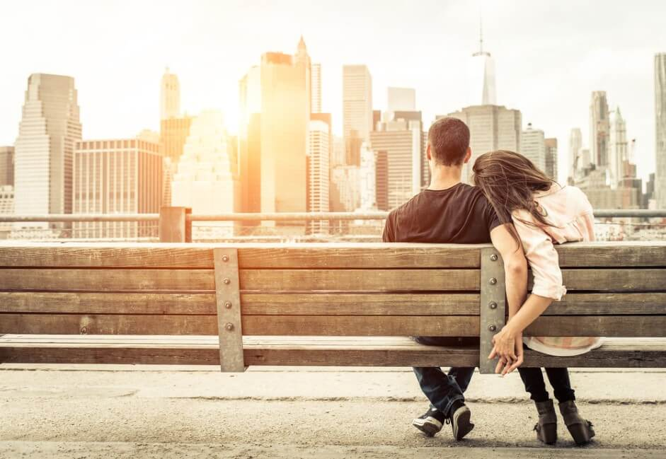 couple relaxing on New york bench