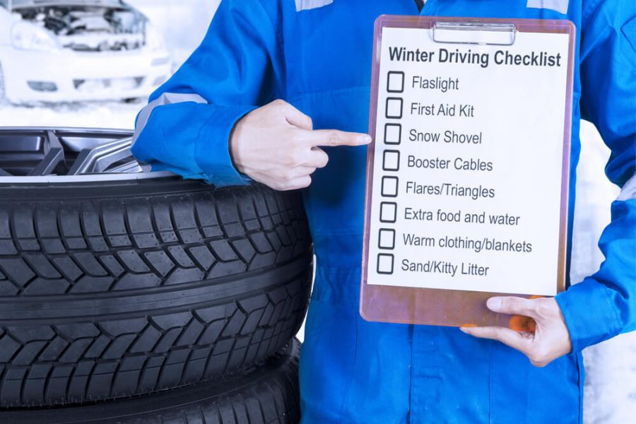 showing a winter driving tips on the clipboard
