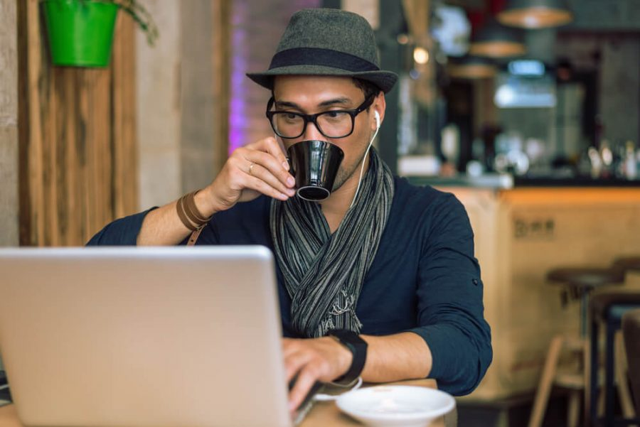Fashionable and stylish young man drinking coffee