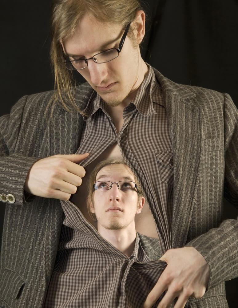 man opening shirt revealing a vision