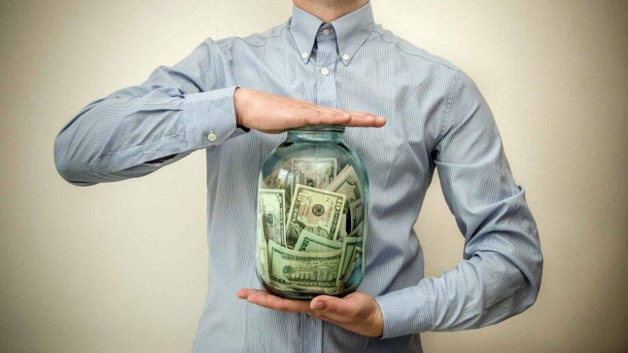man with money jar