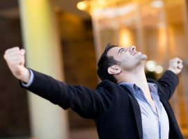 Successful businessman with arms up2
