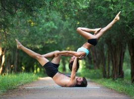 two sporty people practice yoga
