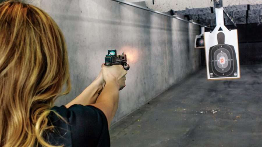 woman practicing in a shooting range