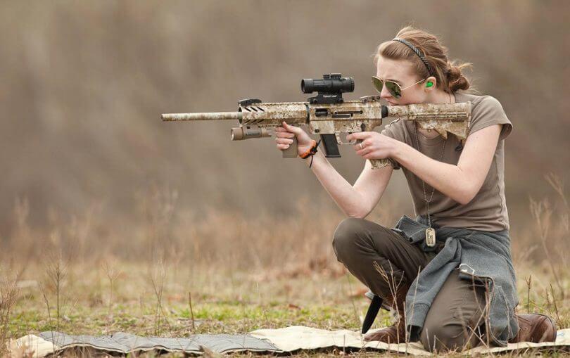 woman using a rifle