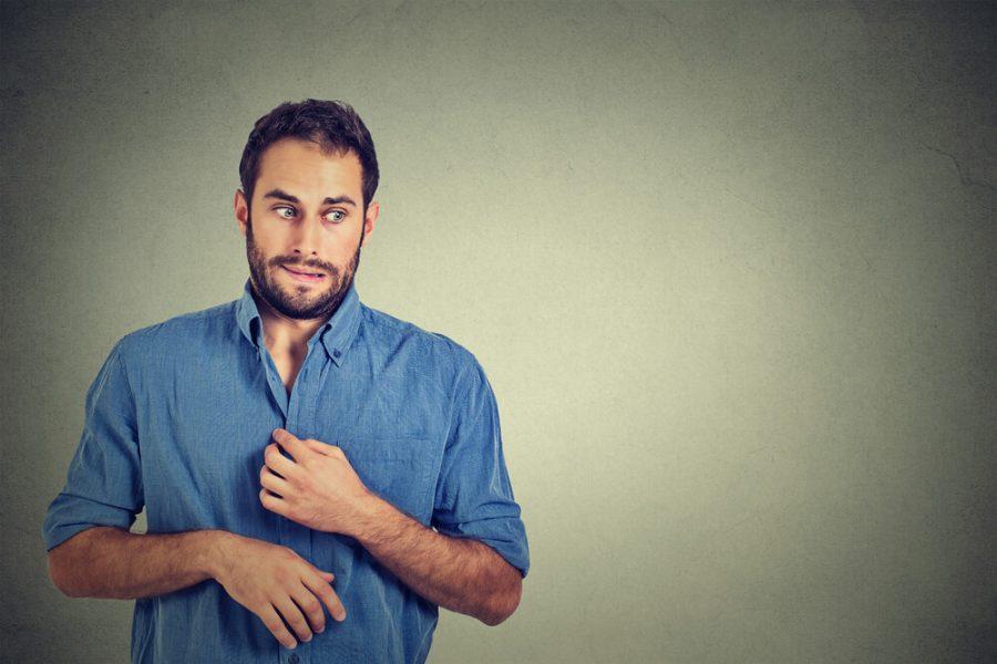 young man opening shirt